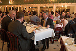 Business men lunching at Galatoire's Restaurant in New Orleans, LA, known for its power lunches.