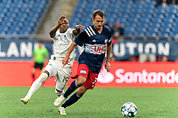 FOXBOROUGH, MA - AUGUST 5: Jake Rozhansky #32 of New England Revolution II dribbles as Jay Tee Kamara #19 of North Carolina FC closes during a game between North Carolina FC and New England Revolution II at Gillette Stadium on August 5, 2021 in Foxborough, Massachusetts.