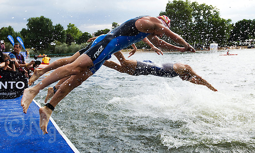 25 JUL 2010 - LONDON, GBR - Competitors re enter the water after completing the first swim lap of the mens race of the London round of the ITU World Championship Series triathlon .(PHOTO (C) NIGEL FARROW)