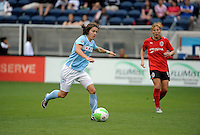 Chicago forward Karen Carney (14) prepares to shoot the ball.  The Chicago Red Stars tied the Atlanta Beat 0-0 at Toyota Park in Bridgeview, IL on June 6, 2010.