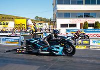 Sep 15, 2019; Mohnton, PA, USA; NHRA pro stock motorcycle rider Jianna Salinas (near) alongside Angelle Sampey during the Reading Nationals at Maple Grove Raceway. Mandatory Credit: Mark J. Rebilas-USA TODAY Sports