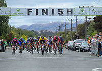 Jensen Plowright (Australia/Team BridgeLane, yellow jersey - centre) charges towards the finish line during stage three of the NZ Cycle Classic UCI Oceania Tour (Martinborough circuit) in Wairarapa, New Zealand on Friday, 17 January 2020. Photo: Dave Lintott / lintottphoto.co.nz