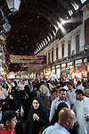 Shoppers walk along the covered market at the Al Hamidiyya Souq in the Old City.