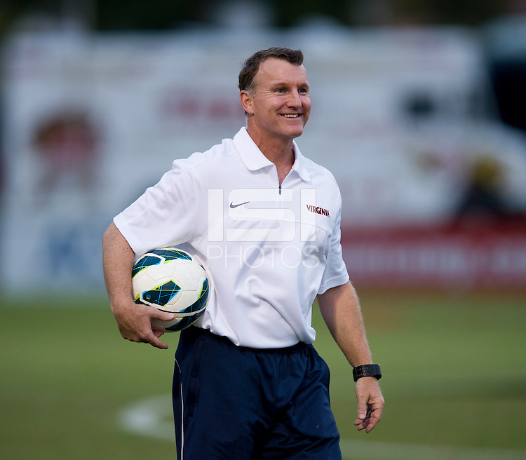 Virginia head coach Steve Swanson watches his team before the game in College Park, MD.  Maryland defeated Virginia, 3-1.