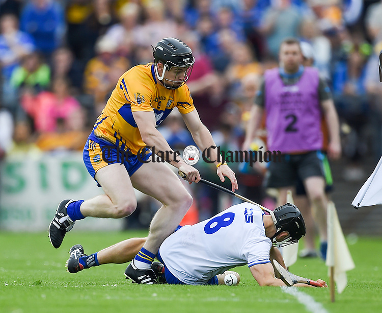 Tony Kelly of Clare  in action against Jamie Barron of Waterford during their Munster  championship round robin game at Cusack Park Photograph by John Kelly.