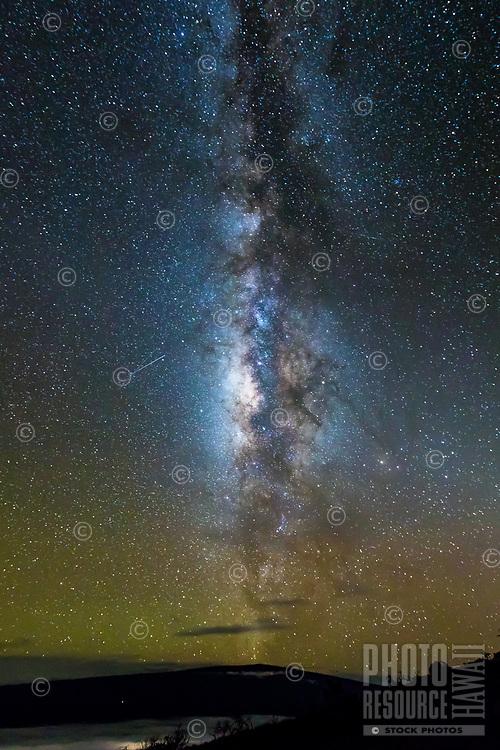 Two shooting stars head toward the Milky Way Galaxy over Mauna Loa, Hawai'i Island.