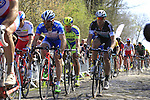 Riders, including Matteo trentin (ITA) Etixx-Quick Step, tackle Sector 18 la Trouee de Arenberg during the 113th edition of the Paris-Roubaix 2015 cycle race held over the cobbled roads of Northern France. 12th April 2015.<br /> Photo: Eoin Clarke www.newsfile.ie