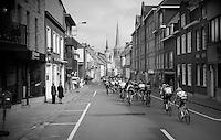 peloton through town<br /> <br /> 71st Dwars door Vlaanderen (1.HC)