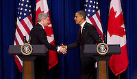 EDS NOTE: Year-end photo for use with YEAR-Diary or for use as desired as a stand-alone package...Prime Minister Stephen Harper shakes hands with United States President Barack Obama after taking part in a joint press conference in the Eisenhower Executive Office Building across from the White House in Washington, DC, on Friday Feb. 4, 2011. THE CANADIAN PRESS/Sean Kilpatrick