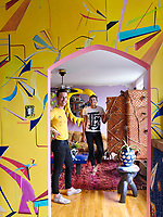The Brooklyn home of Nick Haramis and Misha Kahn, seen in the living room. The yellow printed wallpaper is by Voutsa.