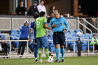 SAN JOSE, CA - MAY 12: Referee Baldomero Toledo and Raul Ruidiaz #9 of the Seattle Sounders during a game between Seattle Sounders FC and San Jose Earthquakes at PayPal Park on May 12, 2021 in San Jose, California.