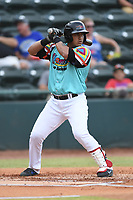 Melvin Novoa (32) of Las Llamas de Hickory at bat during a game against Los Rapidos de Kannapolis at L.P. Frans Stadium on July 17, 2019 in Hickory, North Carolina. The Llamas defeated the Rapidos 7-5. (Tracy Proffitt/Four Seam Images)