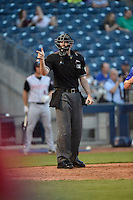 ***Temporary Unedited Reference File***Umpire Nate Tomlinson during a game between the Arkansas Travelers and Tulsa Drillers on April 25, 2016 at ONEOK Field in Tulsa, Oklahoma.  Tulsa defeated Arkansas 4-3.  (Mike Janes/Four Seam Images)