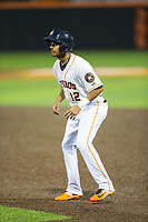 Anibal Sierra (12) of the Buies Creek Astros takes his lead off of first base against the Wilmington Blue Rocks at Jim Perry Stadium on April 29, 2017 in Buies Creek, North Carolina.  The Astros defeated the Blue Rocks 3-0.  (Brian Westerholt/Four Seam Images)