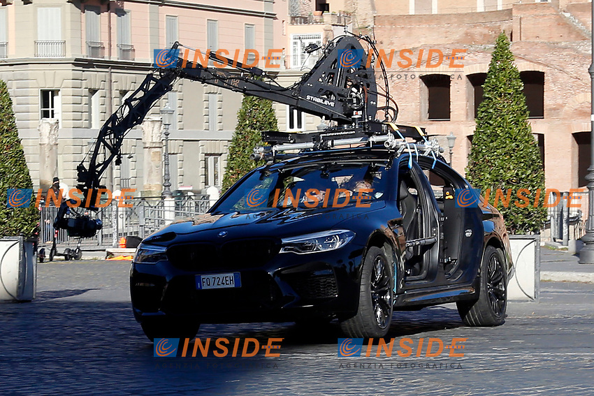 Actor Tom Cruise and actress Hayley Atwell in a car driven by a stuntman hidden in the back of the car, during a an action scene on the set of the film Mission Impossible 7 at Imperial Fora in Rome. <br /> Rome (Italy), November 21st 2020<br /> Photo Samantha Zucchi Insidefoto
