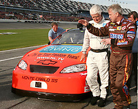 72-year-old NASCAR driver James Hylton, in white uniform, talks fellow driver Ricky Rudd during Daytona 500 qualifying at Daytona International Speedway on Sunday, February 11,  2007.  (Photo by Brian Cleary/www.bcpix.com)