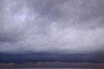 Storm clouds spread across the horizon, Spice Islands, Maluku Region, Halmahera, Indonesia, Pacific Ocean