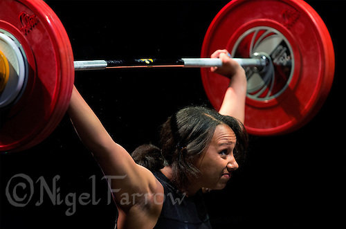 10 MAY 2014 - COVENTRY, GBR - Zoe Smith from Europa / KBT Weightlifting attempts to complete a lift during the women's 63kg category round at the British 2014 Senior Weightlifting Championships and final 2014 Commonwealth Games qualifying event round at the Ricoh Arena in Coventry, Great Britain. Smith, with a combined total for the event of 200kg and having reached the qualifying criteria in her usual 58kg category at the English Championships in February, is eligible for selection for the England team for the 2014 Commonwealth Games in two categories (PHOTO COPYRIGHT © 2014 NIGEL FARROW, ALL RIGHTS RESERVED)
