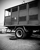 The dreaded Black Maria. Many defendents have died from crashes and exposure to the African heat inside these trucks as they are ferried back and forth from prisons to the courts. The Justice Makers and others are working very hard to have these trucks banned. The worst case ended in the deaths of over 50 men.
