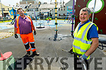 Michael Shine (front right) and Tim O'Sullivan Deep cleaning the playground in Ballybunion on Monday