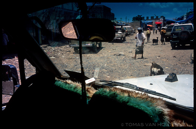 Goats and shoppers are seen through a truck window in the main street market in Hadibu, the largest town on the island of Socotra, Yemen on Tuesday, 17 May 2005.<br />