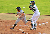 2 July 2011: Tri-City ValleyCats catcher Miles Hamblin crosses the plate as catcher Diomedes Lopez cannot get to the ball during play against the Vermont Lake Monsters at Centennial Field in Burlington, Vermont. The Monsters rallied from a 4-2 deficit to defeat the ValletCats 7-4 in NY Penn League action. Mandatory Credit: Ed Wolfstein Photo