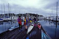 Kayakers prepare for a paddle at Cap Sante Marina, Anacortes, Washington