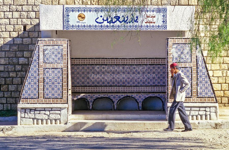 Tunisia, Le Kef.  Tiles decorate city bus stop shelter.