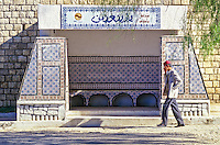 Tunisia, Le Kef.  Tiles decorate city bus stop shelter.