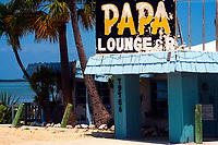 Old Papa Joe's lounge and restaurant landmark with the ocean and palm trees, on Islamorada Islands in The Keys, Florida
