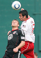 Adam Cristman #7 of D.C. United is beaten on a header by Mike Petke #12 of the New York Red Bulls during an MLS match on May 1 2010, at RFK Stadium in Washington D.C.