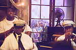 "Over 250 years old, Preservation Hall, located in New Orleans's famed French Quarter, has served as a private residence, tavern, inn, photo studio and art gallery. In 1961, it was christened ""Preservation Hall,""  with the mission of protecting and honoring the historical musical art of New Orleans Jazz.  Each night, eager jazz lovers gather outside its doors hours before its opening at 8:00 pm."