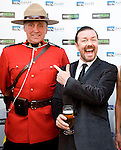 BANFF, AB, CANADA - JUNE 15:  Actor Ricky Gervais, right, posing for photos with Canadian Mounted Police on the red carpet before the 2010 Banff World Television awards on June 15, 2010 at the Banff Springs Hotel in Banff, Alberta, Canada. Photo by Jimmy Jeong *** Local Caption *** Ricky Gervais