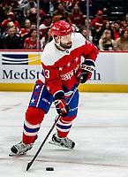 WASHINGTON, DC - JANUARY 31: Radko Gudas #33 of the Washington Capitals starts an attack during a game between New York Islanders and Washington Capitals at Capital One Arena on January 31, 2020 in Washington, DC.
