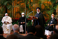 """Ayatollah Seyyed Mostafa Mohaghegh Damad of Iran addresses the meeting, """"Faith and Science: Towards COP26,"""" with Pope Francis and religious leaders in the Hall of Benedictions at the Vatican Oct. 4, 2021. The meeting was part of the run-up to the U.N. Climate Change Conference, called COP26, in Glasgow, Scotland, Oct. 31 to Nov. 12, 2021."""
