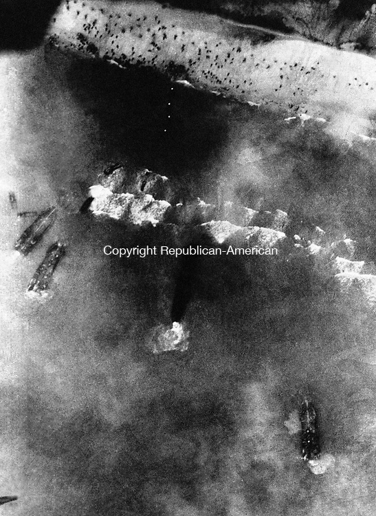 Men, barges, landing craft and assault vehicles storm ashore on a beach in France on D-Day on June 6, 1944. The Allied forces in action during the invasion of the European continent. (AP Photo)