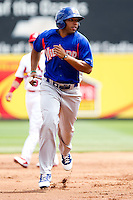Jermaine Mitchell (25) of the Midland RockHounds hurries to third base during a game against the Springfield Cardinals on April 19, 2011 at Hammons Field in Springfield, Missouri.  Photo By David Welker/Four Seam Images