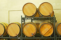 Wooden barrels mounted on special stands with rollers to make it easier to stir the lees, as an alternative to stirring with a stick (batonnage).  Vincent Paris, Cornas, Ardeche, Ardèche, France, Europe