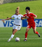 Kristie Mewis (USA) keeps the ball from Hyon Mi Kim (PRK)..FIFA U17 Women's World Cup Final, USA v Korea DPR, Albany Stadium, Auckland, New Zealand, Sunday 16 November 2008. Photo: Renee McKay/PHOTOSPORT