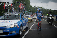 Bjorn Leukemans (BEL/Wanty-Groupe Gobert) returning rain jackets (from teammates) to the team car<br /> <br /> stage 5: Eindhoven - Boxtel (183km)<br /> 29th Ster ZLM Tour 2015