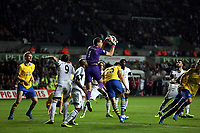 Saturday 28 September 2013<br /> Pictured: Arsenal goalkeeper Wojciech Sxczesny (C) saves the ball yet again<br /> Re: Barclay's Premier League, Swansea City FC v Arsenal at the Liberty Stadium, south Wales.