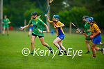 Kerry's Annemarie Leen hand passes the sliotar out of danger as Niamh Mulqueen bears down on her, in the Munster Junior Camogie final