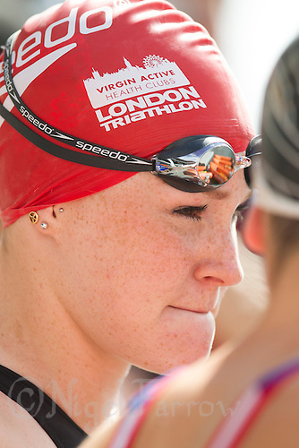 28 JUL 2013 - LONDON, GBR - Lucy Hall talks with Jodie Stimpson as they wait for the start of the Elite Women's race during the 2013 Virgin Active London Triathlon at Excel, Royal Victoria Dock in London, Great Britain (PHOTO COPYRIGHT © 2013 NIGEL FARROW, ALL RIGHTS RESERVED)