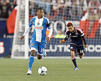 Philadelphia Union substitute midfielder Jose Kieberson (19) brings the ball forward and looks to pass.In a Major League Soccer (MLS) match, the New England Revolution (blue/red) defeated Philadelphia Union (blue/white), 2-0, at Gillette Stadium on April 27, 2013.