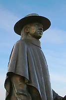 A closeup of the statue memorializing legendary blues guitarist Stevie Ray Vaughan in Town Lake, Austin, Texas.