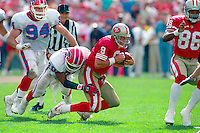SAN FRANCISCO, CA - Quarterback Steve Young of the San Francisco 49ers in action during a game against the Buffalo Bills at Candlestick Park in San Francisco, California in 1992. Photo by Brad Mangin