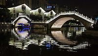 Wenzhou, Zhejiang, China.  Tourist Boat Passing under Bridge Over the Nantong River, at Night.