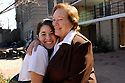 Mount Carmel student Crisina Hnatyshyn gets a welcome hug from Sister Camille Campbell on the first day back to school after Katrina, 2006