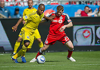 23 April 2011: Toronto FC midfielder Jacob Peterson #23 and Columbus Crew defender Julius James #26 in action during an MLS game between the Columbus Crew and the Toronto FC at BMO Field in Toronto, Ontario Canada..The game ended in a 1-1 draw.