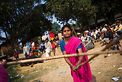 The 47-year-old leader of the Pink Gang, Sampat Pal Devi is seen teaching lathi fighting skills to Aarti (centre), one of the young members of the pink gang. A fiesty woman, barely educated, impoverished mother of five, Sampat Pal Devi has emerged as a messianic figure in the region. Sampath Devi began to work as a government health worker, but she quit soon after because her job was not satisfying enough. She always wanted to work for the poor and not for herself. Taking up issues while being a government worker was difficult, so she decided to quit the job and work for the rights of people...Amidst the gloom of extreme poverty, it's the colour of pink that's calling the shots in this dusty region of Bundelkhand, one of the poorest parts of one of India's northern and most populous states, Uttar Pradesh in India. A gang of vigilantes, called the Gulabi Gang (pink gang) - its 10,000 strong women members wear only pink sarees - is taking up lathi (traditional Indian cudgel) against domestic violence and corruption.